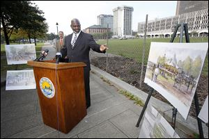 Toledo Mayor Mike Bell talks about the upcoming construction at Promenade Park during a news conference in the park Wednesday. The second phase of the project is expected to be completed by June, 2014.