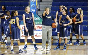 University of Toledo basketball coach Tricia Cullop speaks to her team at its first practice Wednesday.