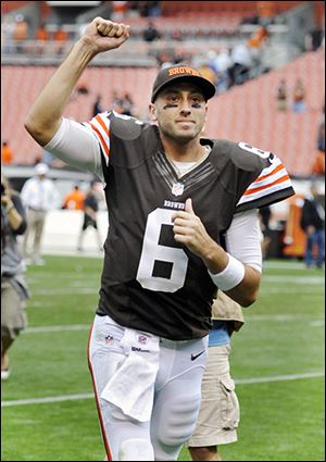 Browns quarterback Brian Hoyer runs off the field after a win over Cincinnati.
