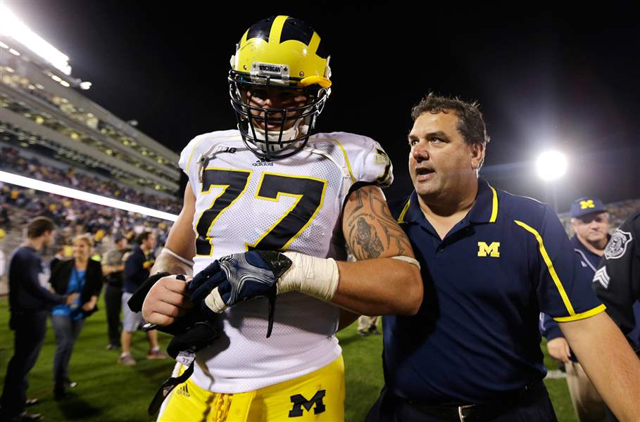 Michigan-head-coach-Brady-Hoke-right