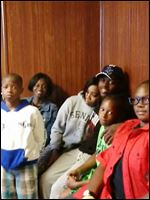 Among Toledo youths at a meeting at the Soul City boxing gym are, from left, Daveon Foster, 12; Alexis Smith, 17; Rhonda Paris, 19; Major Smith, 18; Caleb Jones 10; and Trevonn Smith, 14.