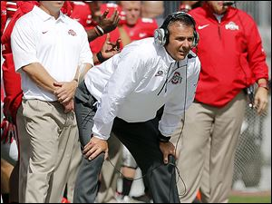 OSU coach Urban Meyer will visit Northwestern for the first time in nearly 12 years Saturday night. While at BGSU, his Falcons used a fourth-quarter rally to win 43-42 in November, 2001.