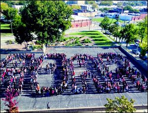 Toledo School for the Arts students spell out 'Roar.'