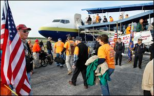 Members of Honor Flight Northwest Ohio board a flight to Washington D.C. on a previous trip.