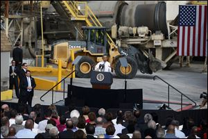 President Obama speaks about the government shutdown and debt ceiling during a visit to M. Luis Construction, which specializes in asphalt manufacturing, concrete paving, and roadway reconstruction in Rockville, Md.