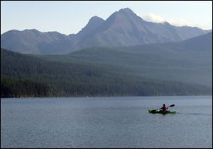 Ingrid Forsmark kayaking on Kintla Lake in Glacier National Park, Mont. Forsmark says she returns to the remote lake near the Canadian border because of its manager, Lyle Ruterbories.