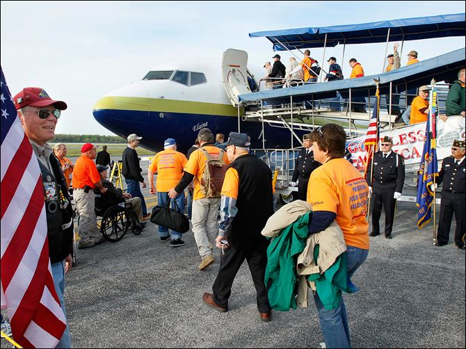 CTY honor25p 10 Members of Honor Flight Northwest Ohio board a flight to Washington D.C. on a previous trip.