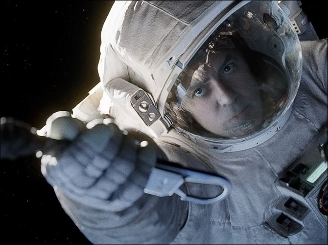 Film Review Gravity This film image released by Warner Bros. Pictures shows George Clooney in a scene from