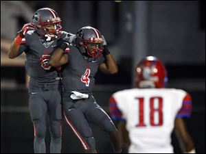 Central Catholic WR Dayton Copeland-Lee (4) celebrates scoring a touchdown with WR Marcus Winters (5).