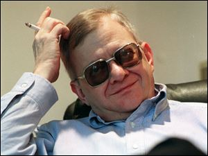 Writer Tom Clancy, shown in 1998, has his name on dozens of books and numerous video games.