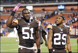 Cleveland Browns outside linebacker Barkevious Mingo (51) and cornerback Leon McFadden (29) celebrate after a 37-24 win over the Buffalo Bills Thursday.