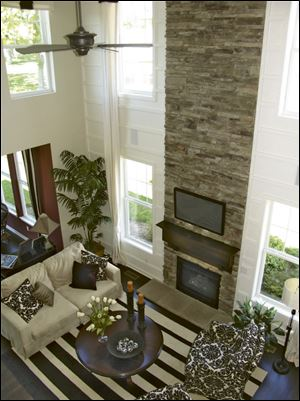 The dramatic stone fireplace rises two stories in the great room.