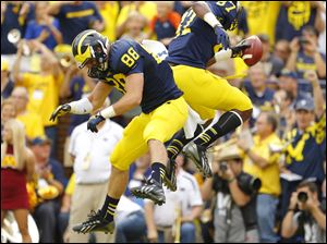 University of Michigan players Jake Butt (88) and Devin Funchess (87) celebrate Funchess's touchdown against the University of Minnesota during the second quarter.