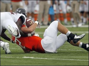 UMass #35, Stanley Andre, breaks up a pass intended for BGSU's #82, Alex Bayer.