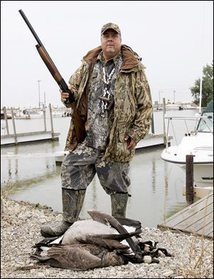 Toledo outdoorsman Mike McCroskey displays geese he shot during the early goose season in September. He has been guiding hunts for more than 30 years.