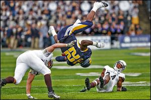 Toledo running back David Fluellen is knocked upside-down by Western Michigan linebacker Kyle Lark. Fluellen finished with 220 yards on 23 carries and scored four touchdowns.