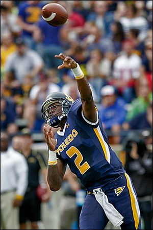 Toledo's Terrance Owens unleashes a pass at the Glass Bowl. The senior was 11 of 25 for 149 yards and a touchdown.