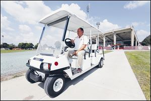Steve Messenger, Operations and Events Coordinator at Bowling Green State University, rides around the stadium taking care of last-minute items before the Falcons' home opener.