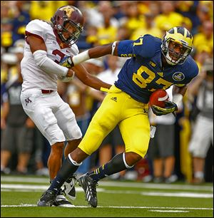 Michigan tight end Devin Funchess breaks away for a touchdown against Minnesota's Martez Sabazz.