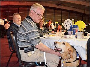 Gary Phipps and assistance dog Cedar during Dealin' for Dogs night.