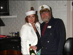 Toledo Ski Club Social Director Sherrie Jacquot Zirn and Dave Zirn serving the champagne at the group's annual party.