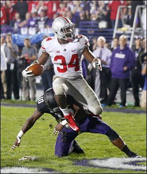 OSU's Carlos Hyde scores past Northwestern's Traveon Henry.
