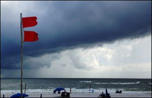 Red flags warn swimmers to stay out of the Gulf of Mexico as a squall from Tropical Storm Karen moves offshore at Gulf Shores, Ala.