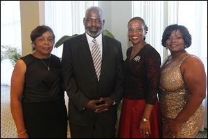 Dr. Marie L. Bush, co-chair; Toledo Mayor Mike Bell, Dr. Deborah Washington, president; and Lisa E. Dubose, event chair. The Alpha Kappa Alpha Sorority, Inc. Fall to Fabulous dance fundraiser in Toledo, Ohio on September 28, 2013.