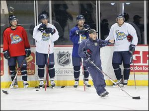Walleye head coach Nick Vitucci instructing forwards during camp.