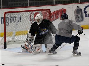 Walleye goalie Neil Conway and forward Stephon Thorne.
