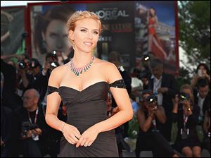 Actress Scarlett Johansson poses for pictures at the Venice International Film Festival in September in Venice, Italy.