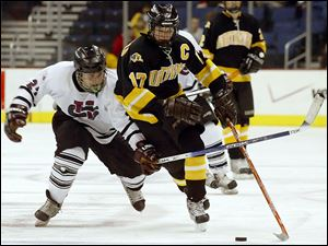 Northview's Alden Hirschfeld, right, skates past University School's Yule Baron in 2006. The Wildcats won the state semifinal but fell in the championship.