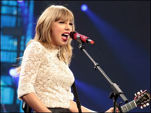 Taylor Swift, pictured, Jason Aldean and most of the major nominees will perform at the Country Music Association Awards next month.