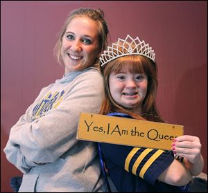 Whitmer High School senior Grace Haskin, left, promoted a campaign to elect  her best friend, Bethany Wissler, homecoming queen last Friday. Miss Wissler's mother bought her the placard.