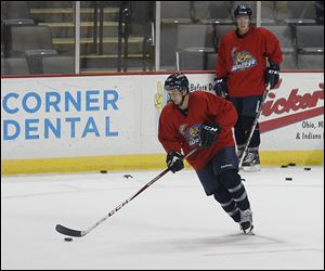 Alden Hirschfeld goes through a drill at a Walleye practice at Huntington Center. Hirschfeld was a captain for Miami University  when it won the 2011 CCHA championship.