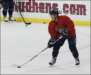 Travis Novak goes through a drill at training camp. The right wing had 11 goals and 23 assists last season when the Walleye finished 37-26-9 in the regular season for a franchise-best 83 points.