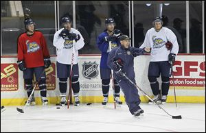 Nick Vitucci instructs his team at training camp at the Huntington Center. Vitucci enters his fifth season as Walleye coach. He was the Storm's coach for three and a half seasons.