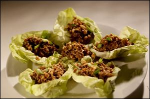Lettuce cups can be incorporated into a rotisserie chicken dinner.