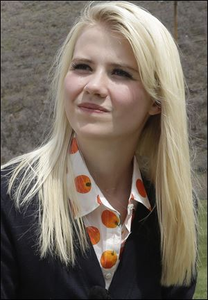 Elizabeth Smart talks with a reporter before an interview in Park City, Utah in May.