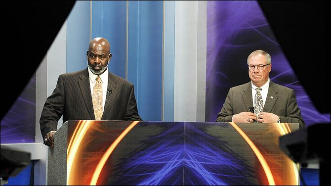 Toledo mayoral candidates Mayor Mike Bell, left, and D. Michael Collins prepare for their first televised debate. Monday's event was at WNWO-TV, Channel 24.