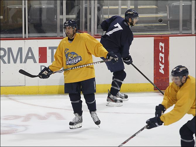 s3skate-1 Mud Hens infielder Mike Cervenak, center, participates in the first day of training camp with the Walleye on Monday. Cervenak, 37, played in hockey travel teams as a youth in Michigan.
