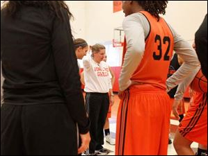 Jennifer Roos, Bowling Green State University's head women's basketball coach, center, instructs her team during practice at the Stroh Center on October 8, 2013.