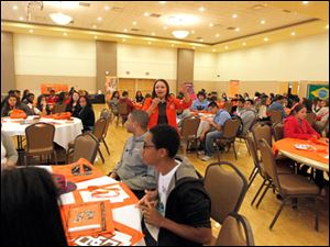 Laura Saavedra, center, Admission Representative at Bowling Green State University, speaks about the university to high school students during an event called