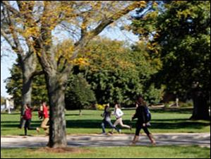 Western International High School students run past BGSU students and faculty on the campus grounds while on a scavenger hunt.