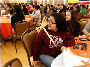 Mariela Trejo, left, from Detroit, and Cecilia Ramirez, right, listen as Laura Saavedra, not pictured, Admission Representative at Bowling Green State University, speaks about the university.