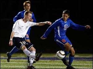 St. John's Jesuit's Adam Naayers (10) moves the ball past  St. Francis de Sales' Jadd Awad (8).
