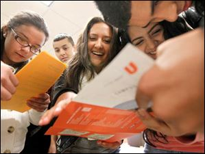 Western International High School students from Detroit from left: Vanessa Varela, 16, David de Luna, 16, Carolina Guiterrez, 16, Analisa Alvarez, 16, and Juan Flores, 16, look over a map of the campus at BGSU for a scavenger hunt during an event called