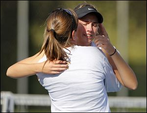 Megan Miller gets a hug from her mother and Northview coach, Susie Miller, after defeating Perrysburg's Erica Fastnacht to win a fourth NLL No. 1 singles title.