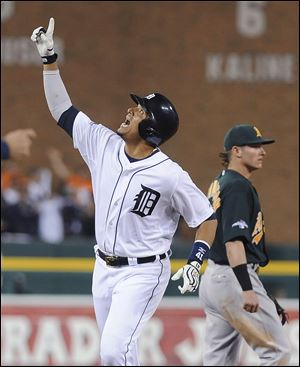 Detroit Tigers' designated hitter Victor Martinez looks skyward after hitting a solo home run to lead off the seventh inning of Game 4 Tuesday in Detroit. Martinez's homer tied up the game.