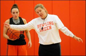 Jennifer Roos, head women's basketball coach, at practice at the Stroh Center on Tuesday, says summer practice helped get her team up to speed faster.